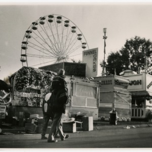 Family walking along the Midway