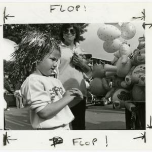 Girl with tinsel hair at the fair