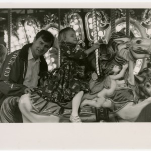 Father and daughter on the merry-go-round