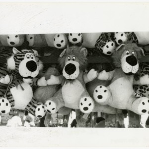 Stuffed tigers and lions look over the Midway at the state fair