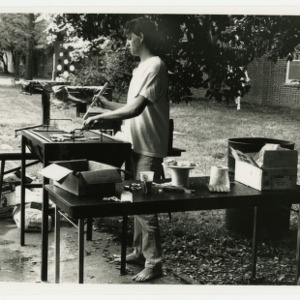 Student grilling out at Tucker Beach