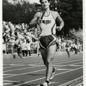 Student relay runner, holding baton
