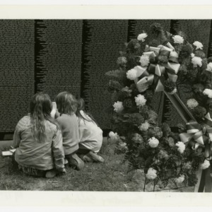 Elementary school students examine The Moving Wall, a memorial to Vietnam Veterans
