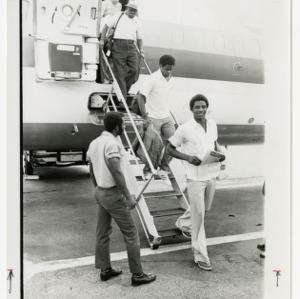 David Thompson leaves an airplane