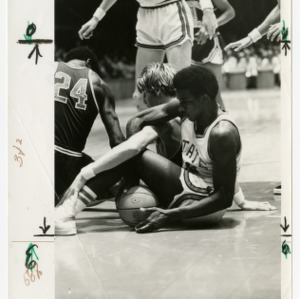 David Thompson in a tangle on the court with another player