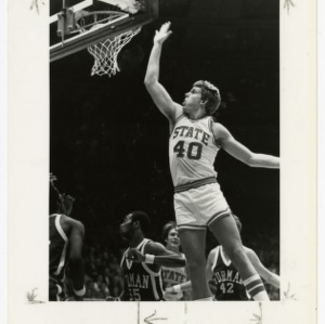 NC State basketball's forty makes a basket against Furman