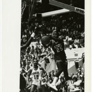 NC State basketball's Whittenburg (25) receives a pass under the net