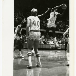 NC State basketball's Whittenburg (25) leaps to make a pass