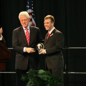 Bill Clinton congratulates John Coggin