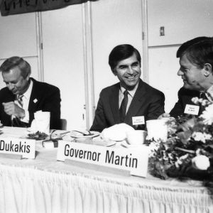 Governor James B. Hunt, Governor Michael Dukakis, and Governor James G. Martin on a panel at the 1987 Emerging Issues Forum