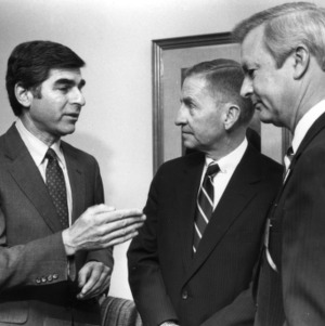 Governor Michael Dukakis, H. Ross Perot, and Lt. Governor Bob Jordan at the 1987 Emerging Issues Forum