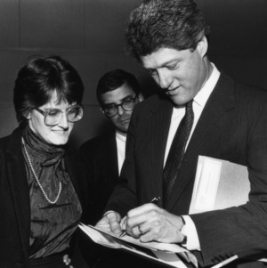 Governor Bill Clinton signing autograph at the 1988 Emerging Issues Forum