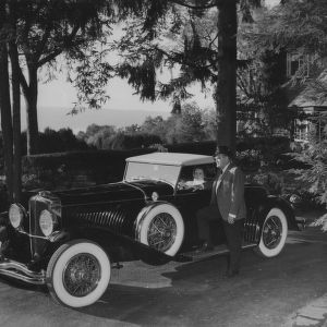 Roy H. Park and daughter Adelaide with car