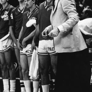 Coach Jim Valvano and basketball players at game