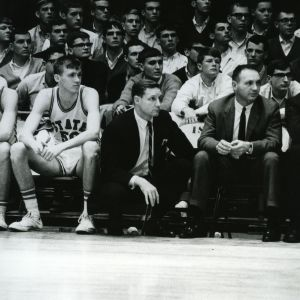 Coaches and players at basketball game
