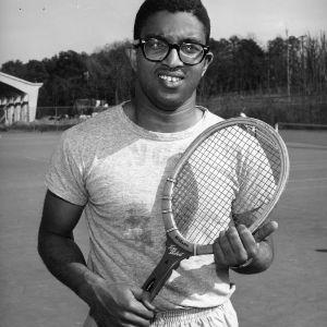Irwin Holmes on tennis court