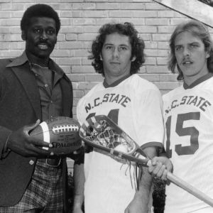North Carolina State running back Willie Burden (left) with lacrosse players Bob Flintoff (center) and Stan Cockerton (right)
