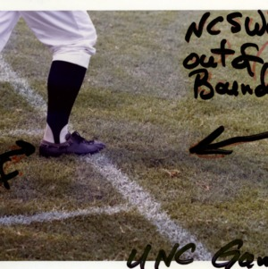 Referee establishing N. C. State as out of bounds during football game with U.N.C.