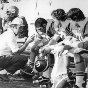Coach Dale Haupt instructing Tom Higgins, Tom Prongay, and Frank Haywood