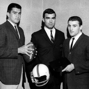 Football players Roman Gabriel, Skip Matthews, and Joe Scarpeti