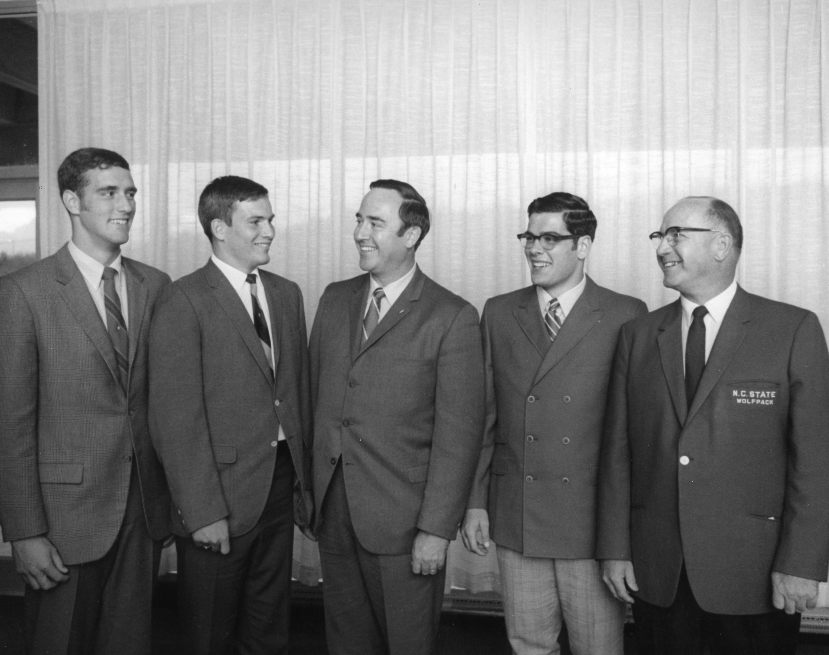 N. C. State football players with Governor Robert Walker, Craig John, and Coach Earle Edwards