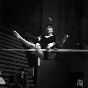 Gymnast on uneven bars