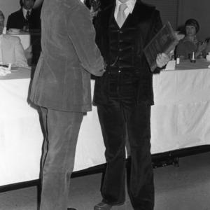 Fencer Steve Dickman receiving MVP award from Coach David Sinodis