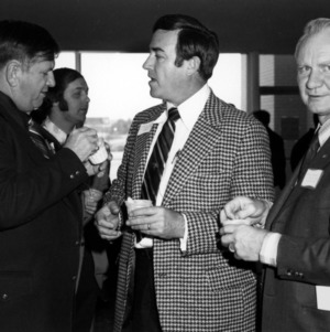 Governor Robert W. Scott with others at event