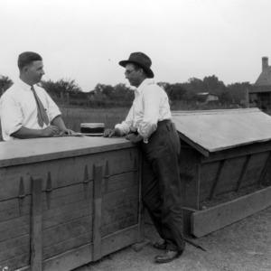 F. H. Jeter and a farmer on farm