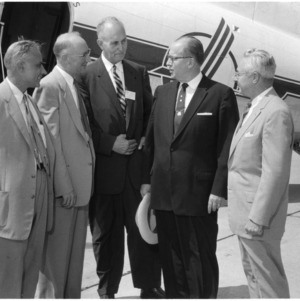 Dean H. Brooks James and others in front of airplane
