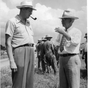 I. O. Schaub with others in field