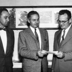 Dr. John Clark Osborne, Dr. R. L. Lovvorn and Dr. E. G. Battle with a $3500 check from Eaton Lab Grant