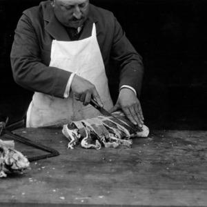 Man preparing pork