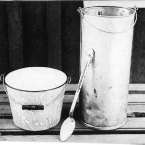 Enamel pail and shotgun can