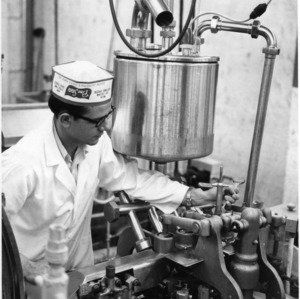 Employee operating dairy equipment, Pine State Creamery