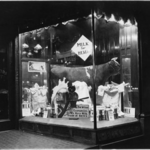 Storefront window display at Belk Brothers Department Store, Part of promotional milk campaign