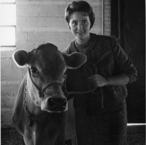 Mary Sink, 1962 Dairy Princess, with cow at North Carolina State College Dairy Farm