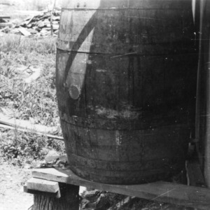 Barrel of water outside of brooder house