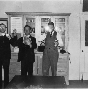 T. T. Brown, Roy S. Dearstyne, and Clifton F. Parrish in lab