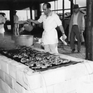 Dr. Henry W. Garren, C. J. Maupin, and W. C. Mills, Jr. barbecuing chicken
