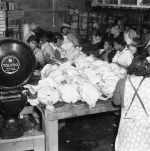Workers preparing turkeys to be boxed