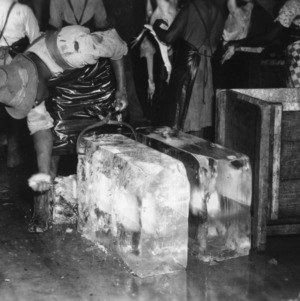 Man preparing ice for turkey dressing at Peachland Dressing Plant