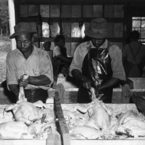 Two men processing turkeys at Peachland Dressing Plant