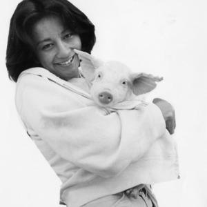 Woman holding piglet