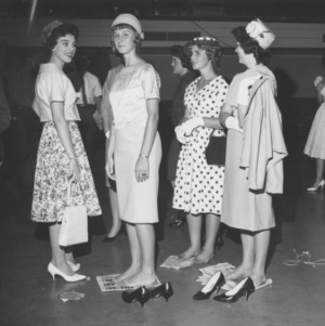 4-H girls with shoes off during 4-H Dress Revue