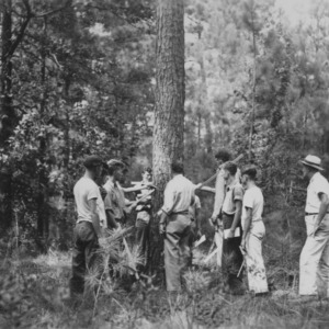 Fred Claridge gives instruction in measuring tree diameters at Bladen Lakes State Forest