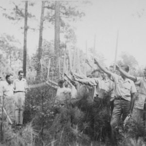 Fred Claridge giving instruction in timber scaling and estimating at Forestry Camp for Farm Boys, August 26-31, 1946, Bladen Lakes State Forest