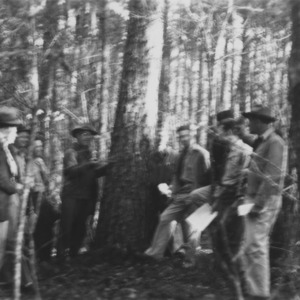 Carl W. Strauss conducting a demonstration in timber scaling with farm foresters