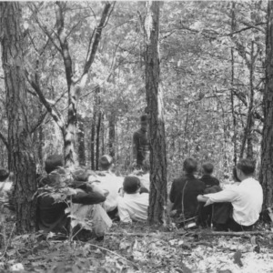 Farmers and vocational students studying methods of management for mixed stands of pines and hardwoods