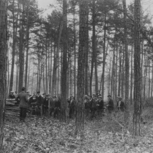 W. B. White, vocational teacher and his class of Dobson High School boys who are thinning this forest to pay their way to Washington, D.C.